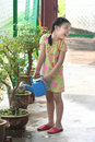 Free Girl Watering Plant Royalty Free Stock Photography - 1288047
