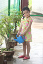 Free Girl Watering Plant Royalty Free Stock Image - 1288816