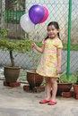 Free Girl Holding Balloons Royalty Free Stock Image - 1289116