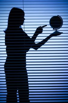 Silhouette Of Woman With Globe (blind) Stock Images