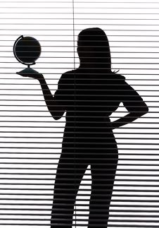 Silhouette Of Woman With Globe (blind) Royalty Free Stock Image
