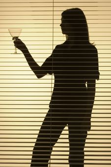 Silhouette Of Woman With Glass (blind) Stock Images