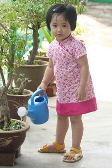 Free Girl Watering Plant Royalty Free Stock Images - 1283489