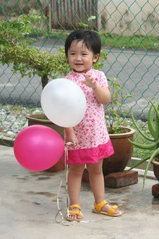 Free Girl Holding Balloons Royalty Free Stock Images - 1283779