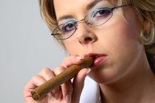 Free Blond Business Woman Smoking A Cigar Royalty Free Stock Photo - 1286465