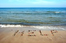 Free Word HELP On Beach Sand Stock Photos - 1286593