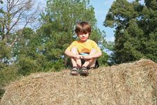 Free Boy Sitting On Haybale Royalty Free Stock Photos - 1287008