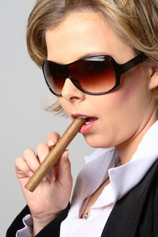 Blond Woman Smoking A Cigar With Sunglasses Royalty Free Stock Photo