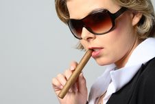 Blond Woman Smoking A Cigar With Sunglasses Royalty Free Stock Photography