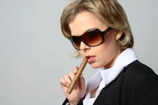 Blond Woman Smoking A Cigar With Sunglasses Stock Photography