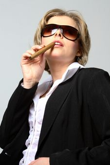 Free Blond Business Woman Smoking A Cigar Stock Photo - 1287290