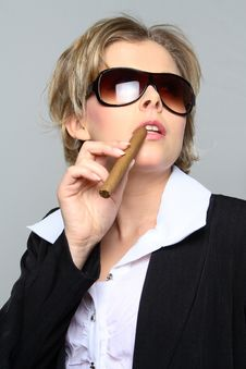 Free Blond Business Woman Smoking A Cigar Stock Images - 1287334