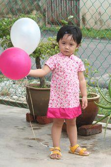 Free Girl Holding Balloons Stock Photo - 1287900