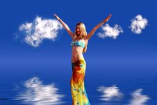 Girl On Blue Sky Royalty Free Stock Photo