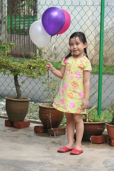 Girl Holding Balloons Royalty Free Stock Image