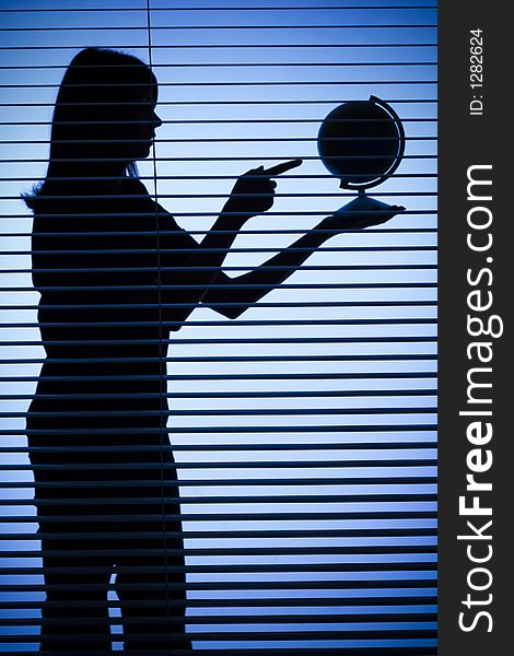 Silhouette of woman with globe (blind)