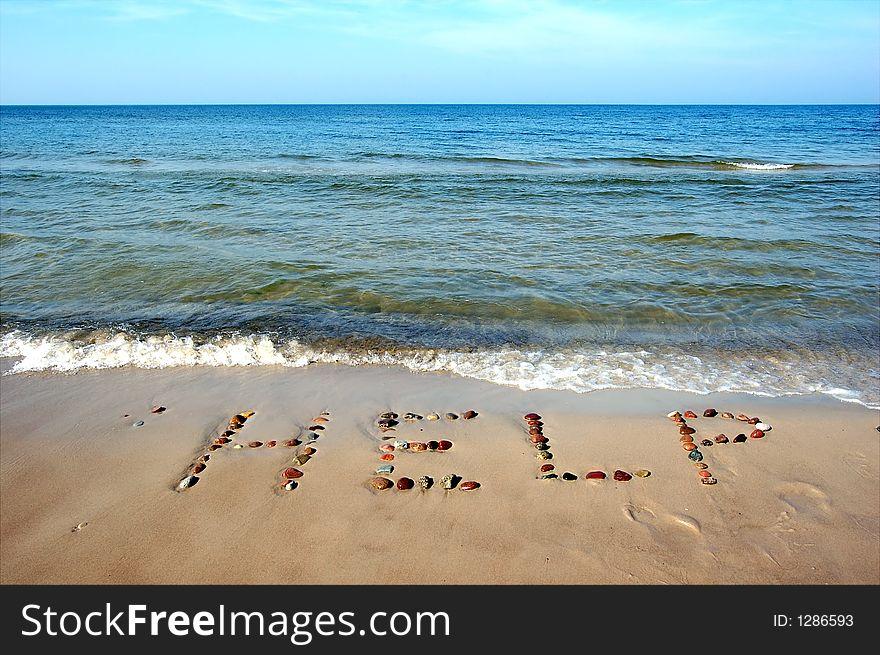 Word HELP on beach sand