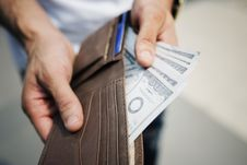 Free Man Holding Brown Leather Bi-fold Wallet With Money In It Stock Photography - 128036972