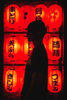 Free Man Standing Beside Red Chinese Lanterns Royalty Free Stock Photo - 128037135