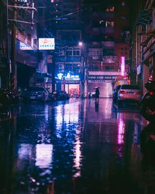 Free Person Under Umbrella Walking On Street Royalty Free Stock Photos - 128037168