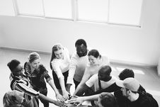 Free Grayscale Photography Of People Doing Team Hand Cheers Royalty Free Stock Images - 128037259