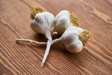 Free Close-Up Photo Of Three Garlic On Wooden Surface Stock Photography - 128037782