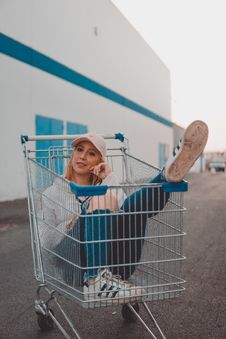 Free Woman Sitting Inside Grocery Cart Royalty Free Stock Image - 128194076