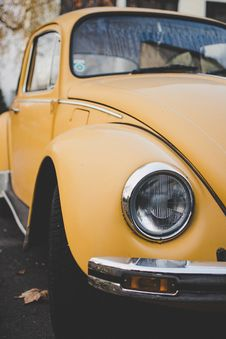 Free Yellow Volkswagen Beetle Coupe Parked On Gray Concrete Surface Royalty Free Stock Image - 128194356