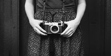 Free Monochrome Photo Of Person Holding Vintage Camera Stock Image - 128194401