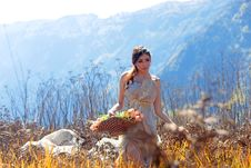 Free Woman Holding Basket Of Flowers Royalty Free Stock Photography - 128194797