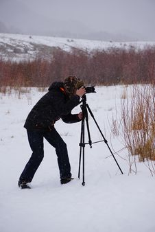 Free Man Taking Photo In The Middle Of Snow-covered Ground Stock Photo - 128400000