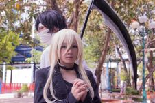 Free Male And Female Anime Character Cosplay With Scythe Beside Tree Stock Images - 128405204