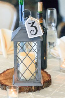 Free Selective Focus Photography Of Candle Lantern On Table Royalty Free Stock Photo - 128405245