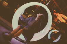 Free Woman Sitting On Swing Chair Royalty Free Stock Photo - 128405285