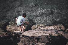 Free Boy Playing With Stick Near Water Stock Photo - 128405420