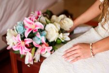 Free Woman Wearing White Bridal Gown While Holding Assorted-color Bouquet Flowers Stock Photos - 128405503
