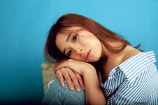 Free Woman Leaning Her Head On Her Knee Royalty Free Stock Photos - 128557938