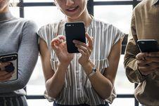 Free Three People Using Smartphones Stock Photo - 128557960