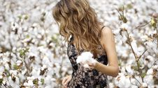 Free Woman In Black And White Floral Dress Holding Cotton Royalty Free Stock Photos - 128557978