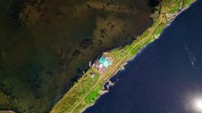 Free Satellite View Of Land Beside Body Of Water Stock Images - 128558074