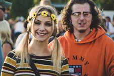 Free Woman Wearing Sunflower Crown Beside Man In Orange Tommy Hilfiger Hoodie Stock Image - 128558161
