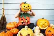 Free Child Holding Jack- O-lantern Royalty Free Stock Photo - 128558465