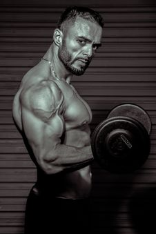 Free Person Lifting Dumbbell Stock Images - 128558494