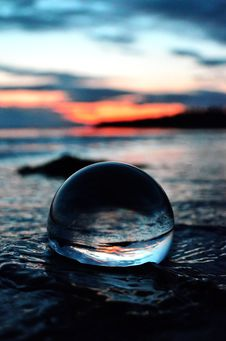 Free Clear Glass Ball On Shore In Tilt Shift Lens Photo Stock Photography - 128687332