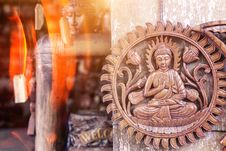 Free Buddha Brown Wooden Wall Decor Hanging On Gray Surface Royalty Free Stock Photos - 128687598