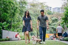 Free Man In Gray Crew-neck T-shirt Walking Beside Woman In Black V-neck Dress Stock Photos - 128687653