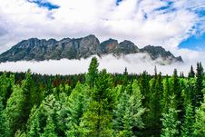 Free Mountain Covered With Fog Under Cloudy Sky Stock Images - 128687674