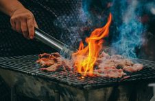 Free Close-Up Photo Of Man Cooking Meat Royalty Free Stock Images - 128701459