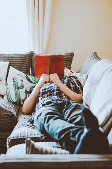 Free Photo Of Man Lying On Bed While Reading Book Stock Photo - 128807980
