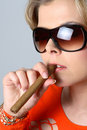 Free Blond Woman Smoking A Cigar With Sunglasses Stock Images - 1297874